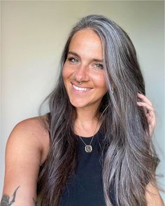 25 Women Who Quit Dying Their Hair and Look so Amazing You'll Want to Join Them | Thinking of going gray? These women are sharing their journey with growing in their gray and growing out their hair dye and showing us all how to go gray gracefully. They'll inspire you to ditch your hair dye and let your gray grow in too, I promise! Grey Hair Under 40, Grey Hair At 40, Dying Your Hair Grey, Grey Hair Young, Under Hair Dye, Red Hair Going Grey, Purple Grey Hair, Grey Blonde Hair, Lilac Hair
