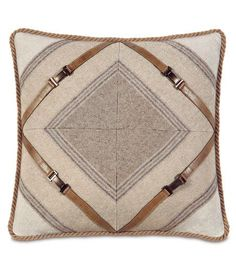 Color blocking and mitred trims, plus leather belt embellishment, takes this pillow to magnificent.