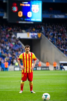 Lionel Messi of FC Barcelona prepares to shoot a penalty and score the opening goal during the La Liga match between RCD Espanyol and FC Barcelona at Cornella-El Prat Stadium on March 29, 2014 in Barcelona, Catalonia.