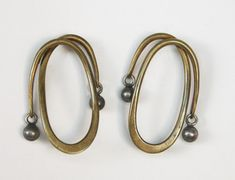 """Art Smith, American. Earrings, c. 1950's. Silver and brass. Stamped """"Art Smith"""" 2"""" high x 1 1/4"""" wide. One of the leading modernist jewelers of the mid-twentieth century, Smith trained at Cooper Union. Inspired by surrealism, biomorphicism, and primitivism, Art Smith's jewelry is dynamic in its size and form. Although sometimes massive in scale, his jewelry remains lightweight and wearable. See """"From the Village to Vogue: The Modernist Jewelry of Art Smith"""". Price on request."""