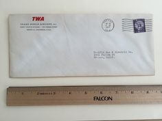 """Item: fc_19570520_3 Advertising cover approx. 4"""" x 9 1/2"""" Condition: very good –  yellowing due to age and minor creases  TWA (logo) TRANS WORLD AIRLINES, INC. Crest Theatre Building 1924 Fresno Street Fresno 21, California, USA  Postmark: FRESNO MAY 20 11 AM 1957 CALIF. Stamp: 3c Liberty First Class  Addressee: Pacific Gas & Electric Co. 1401 Fulton Street Fresno, Calif.  Back cover: Fly the finest … FLY TWA – world map of TWA flight routes and cities: San Francisco Oakland Los Angeles…"""