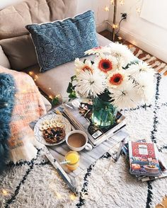 Love the pillows, textured rug, flowers and fairy lights! You cannot go wrong with these four items