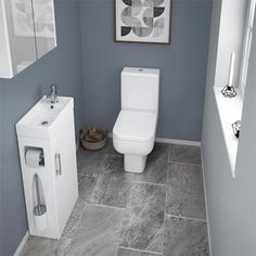 The gorgeous Milan compact complete cloakroom unit is a cleverly designed fixture that houses a vanity unit, toilet brush and toilet roll holder. Cloakroom Toilet Downstairs Loo, Toilet Vanity Unit, Cloakroom Vanity Unit, Small Wc Ideas Downstairs Loo, Cloakroom Basin, Vanity Units, Washroom, Small Bathroom Suites, Cloakroom Suites