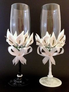 Hand decorated one of a kind wedding champagne glasses for a unique bride.