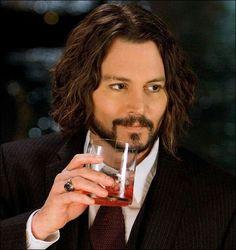 Johnny depp having a drink