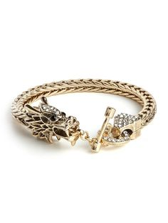 This knockout cuff speaks for itself. With its oversized dragon motif, it's fearlessly bold and fabulously fierce. We love it.