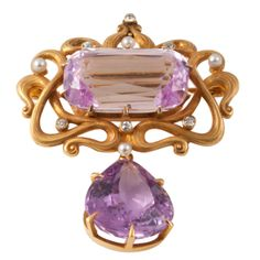 Pink Kunzite and Pink Tourmaline set pin with detachable drop down pendant loop. The front scroll work accented by alternating Diamonds and Pearls, c. 1900