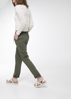 Flowy baggy trousers with twin side pockets and twin welt pockets on the back. Drawstring smocked waist and contrast trims. Baggy Trousers, Trousers Women, Outlet, Capri Pants, United Kingdom, Mango, Fashion, Pants, Elastic Waist