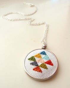 cross stitch pendant-- just need to find some small cross-stich frames to make this