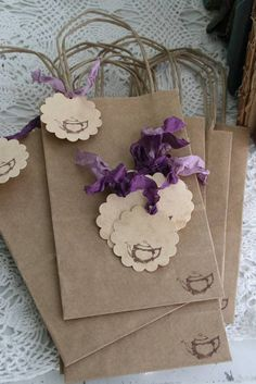 Scalloped tags with purple seam binding