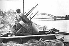 A quadmount on trailer downstream from the bridge at Remagen, March 1945