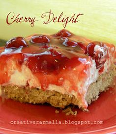Creative Carmella: Tasty Tuesday.......Cherry Delight Crust:  1 package of Keebler Sandies Cookies  1/2 stick butter (room temp)     Topping:  1 small container (8oz)  Cool-Whip (chilled but not frozen)  3 Cups Powdered Sugar  1 block cream cheese (softened)  1 can Cherry Pie Filling
