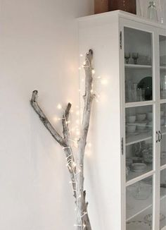 Starry Starry String Lights! • Year Round Home Decor using Christmas lights or firefly lights. • Tons of Tips and Ideas! Including, from 'annaleena's hem', this lovely idea wrapping a large branch with string lights.