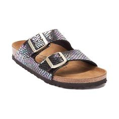 Step into sandal season with the luxe look and iconic comfort of the new Arizona Sandal from Birkenstock! Rocking Birkenstock's signature 2-strap design, this Arizona Sandal features synthetic leather uppers with iridescent snake prints, adjustable buckle straps, and an anatomically correct cork and latex footbed that molds to the contours of your feet, promoting comfort, balance, and support.