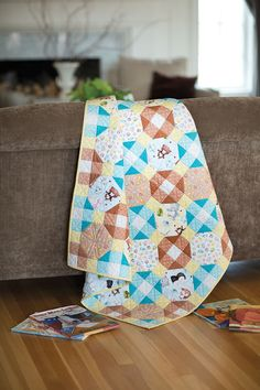 Make this quilt for your little snuggle buddy. It's simply made with adorable animal prints. This pattern meets the guidelines established by the Quilts for Kids organization. Click to learn more about QFK.
