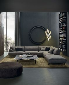 Low sofa looks modern, but overstuffed pillows make it comfortable. Super sexy space. Cosy Living Room Grey, Living Room Ideas Modern Contemporary, Modern Living Room Design, Dark Floor Living Room, Monochromatic Living Room, Dark Living Rooms, Modern Sofa Designs, Modern Lounge, Grey Room