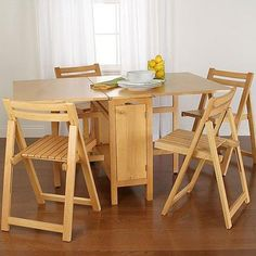 Expandable Dining Room Tables for Small Spaces - http://quickhomedesign.com/expandable-dining-room-tables-for-small-spaces/?Pinterest