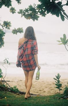 A flannel over a swimsuit, a bottle of wine. Perfect lake outfit + accessory.