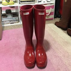 Hunter Original Tall Gloss Rain Boot Military Red These boots are in great condition! I wore them twice but somehow there is a scuff on the back of the right heel (see the second picture). I'm not sure how it happened since I only wore them twice and they're practically brand new! They are the military red color purchased from Nordstrom. Women's size 8. Other than the scuff they're in great condition! I can include the original box if wanted. Hunter Boots Shoes Winter & Rain Boots