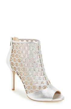 Free shipping and returns on Badgley Mischka Holt II Glittery Cage Sandal (Women) at Nordstrom.com. Breezy, glittery chain-link cutouts front the fine mesh panels of a bootie-inspired sandal styled with an open toe and a shimmery setback stiletto.