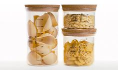 Earl Storage set of 3 borosilicate glass jars with cork stoppers by Mode Studio.