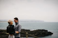 Coast line engagement photo session | Lauren + Viktor's engagement photoshoot on the North Coast of Ireland by Honey and the Moon Photography www.honeyandthemoonphotography.co.uk