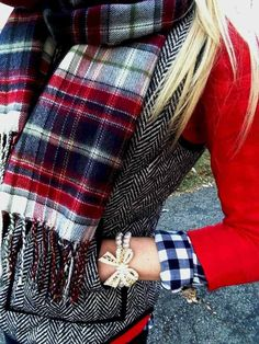 Herringbone vest with red shirt and plaid scarf.