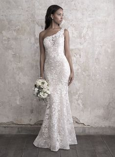 One Shoulder Lace Fit And Flare Wedding Dress on Kleinfeld Bridal | Statuesque and elegant, this one-shoulder lace gown features a garden of floral appliques.