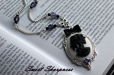 Black and white Gothic lolita skull cameo necklace with purple crystal beads    www.etsy.com/shop/SweetSharpness