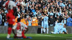 Argentine striker Sergio Aguero is jumped on by team-mates after he netted an injury-time winner against QPR as Manchester City became English Premier League champions for the first time in 44 years.