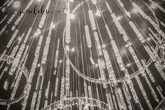 Wedding chandelier. I'm excited to share photos from Ashlee and John's Wedding at Hyatt Atlanta Perimeter at Villa Christina. My favorite element was the circle ceremony and the marriage covenant that she displayed at the reception. Photo Credit: Taun Henderson Photography