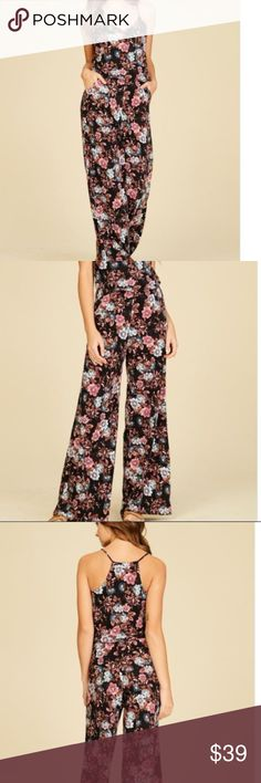 Knit jumspuit with floral print Knit jumpsuit featuring floral print, v neck, strap, sleeveless, racer back, elastic waist, full length, wide leg, flare, loose, relaxed, soft and snug material. Fabric: Poly Spandex  Content: 97% POLY 3% SPAN Pants Jumpsuits & Rompers
