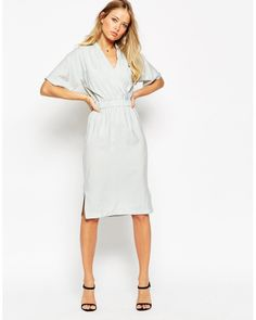 Dress by ASOS Collection Woven fabric Wrap front Stretch elasticated waist  Patch pockets Side seam splits Regular fit - true to size Machine wash  Viscose 7f99d354e