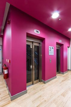 Office Design - Hallway - Stairwell - Signage - Pink - Magenta - Accent Wall - Levels - Office Fit Out - The Chancery Building, Dublin by Think Contemporary