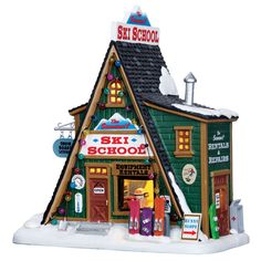 The traditional A-frame architecture of the Summit Ski School makes this Lighted Building stand out in your Christmas Village. Bright lights shine through a large front window, making the school's interior easily visible.