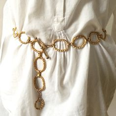 """Vintage 80's Goldtone Chain Belt Super cool large chain link belt from the 80's. Has a little tarnish of the metal, but I call it patina. The belt measures 38"""" in length. Accessories Belts"""