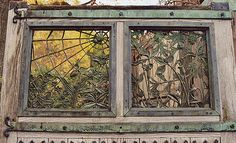 Beautiful wrought-iron window. Wish the entire piece was pictured.