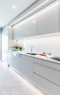 """Very cool contemporary handleless kitchen just finished in Greystones. Colour """"Silver Moonlight"""" by Colourtrend, LED lighting , quartz worktop Caesartone """"Organic White"""". Modern Grey Kitchen, Contemporary Kitchen Cabinets, Contemporary Kitchen Design, Minimalistic Kitchen, Minimalist Kitchen Counters, Modern Contemporary, Luxury Kitchen Design, Kitchen Room Design, Interior Design Kitchen"""