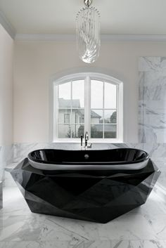 The design above by Rainey Richardson is one of the most intense bathroom ideas in the market, featuring the iconic Diamond Bathtub from Maison Valentina is a perfect example of how versatile her style really is. This designer can work with modern and contemporary elements while mixing them perfectly with other classic ones and still create an insanely astonishing design that will leave anyone breathless!