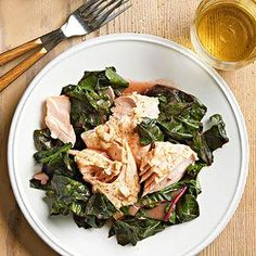 Poached Salmon with Swiss Chard --- Vitamin-loaded Swiss chard and heart-healthy salmon are a dream team for healthy eaters. Dressed up in a tangy honey-Dijon vinaigrette, this low-calorie dinner just tastes indulgent. Healthy Salmon Recipes, Healthy Food Options, Vegan Recipes Easy, Clean Eating Recipes, Organic Recipes, Seafood Recipes, Healthy Dinner Recipes, Vegetarian Recipes, Vegetarian Sandwiches