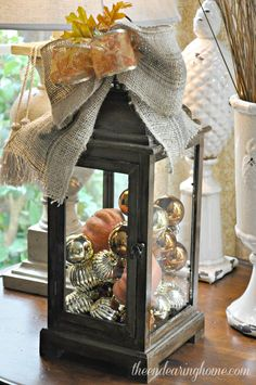 Fixed Up For Fall Lantern. Hmmm I have a couple old lanterns to try this