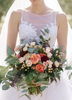 Beautiful Hand Tied Wedding Bouquet Which Includes: Peach English Garden Roses, Blush Spray Roses, Blush Dahlias, Peach Hypericum Berries, Marsala Florals, Several Varieties Of Greenery & Foliage; Silver Dollar Eucalyptus, Green Maiden Hair Fern, Additional Greenery