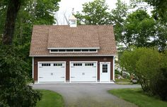 22' x 28' Elite Cape Garage  Upgrades shown here: Duratemp®️ T-1-11 siding, Window upgrades, Extra windows, Carriage style overhead door with Stockbridge glass, Mini shed dormer with transom windows, Cupola & weathervane.