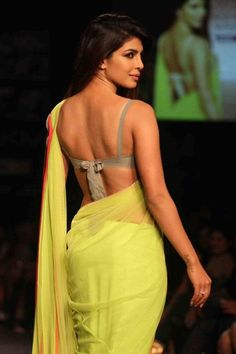 Priyanka Chopra in beautiful green designer plain georgette saree with embellished border paired with grey designer sleeveless saree blouse for back.