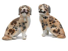 A pair of Chinese Export figures of dogs, late 18th-early 19th century