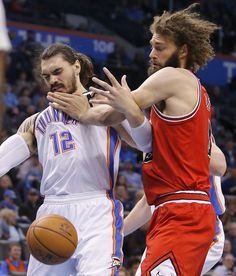 Oklahoma City's Steven Adams (12) fights with Chicago's Robin Lopez (8) for the ball during an NBA game between the Oklahoma City Thunder and the Chicago Bulls at Chesapeake Energy Arena in Oklahoma City, Wednesday, Feb. 1, 2017. Photo by Bryan Terry, The Oklahoman