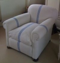 Use vintage Hungarian striped linen to upholster an old arm chair as seen in country living