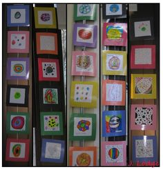 """Pinterest-inspired decorating in the library!  2nd graders made dots after reading The Dot by Peter H. Reynolds.  The picked out """"frames"""" and signed their art.  Then I laminated the dots and strung them together using paperclips.  They definitely make the library more colorful!"""