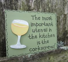 "Hand Painted Wooden Green Funny Wine Sign, ""The most important utensil in the kitchen is the corkscrew."" from on Etsy. Saved to funny drink."