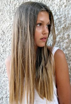 Medium brown hair with ombre highlights.